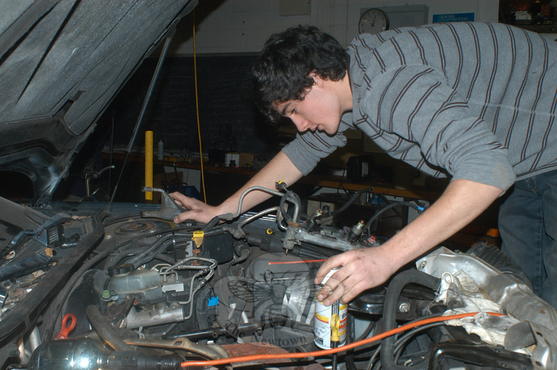 Christian Sayegh does some work under the hood.   (Hutchison photo)