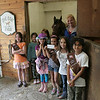 Newtown Brownie Troop 50233 members visited Zoar Ridge Stables on Monday, May 7, and brought a special gift with them. While they were there in part to meet stables owner Annette Sullivan and see some of the horses currently living at the rehabilitation farm, the girls were also on their field trip to present Mrs Sullivan with a $100 donation the girls raised through their sales of Girl Scout cookies this spring. Ms Sullivan takes in rescue horses and horses have been abandoned or put up for auction. She and her staff, who also offer riding lessons at the Sandy Hook farm, rehabilitate the horses for a minimum of six months. The Brownies met a number of the Zoar Ridge horses, including recent arrival Belle, seen here looking out from the washing stall.   (Hicks photo)