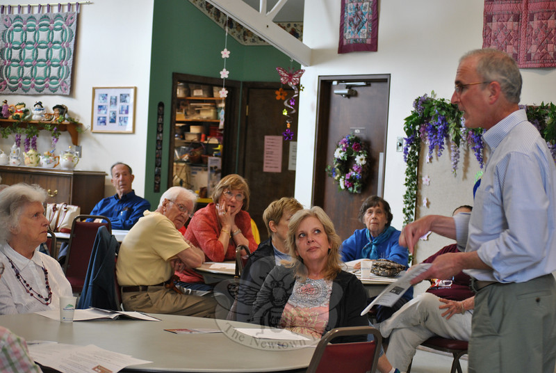 Eric Freedman, right, talks to an attentive audience at the Newtown Senior Center, Tuesday, May 22, concerning Medicare fraud and scams aimed at senior citizens.   (Crevier photo)