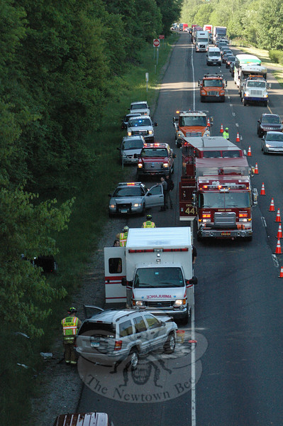 Two motorists who were traveling in opposite directions on Interstate 84, just west of the Bancroft Road overpass, were involved in an accident at about 8:08 am on May 18. The crash involved a SUV and a coupe. The identities of the drivers were not available from state police before the deadline for this edition of The Bee. Sandy Hook Volunteer Fire & Rescue Company Chief Bill Halstead, who responded to the scene with firefighters, said that had the angle of impact been more frontal, the crash could have been much more serious. Both drivers were transported to Danbury Hospital by Newtown Volunteer Ambulance Corps as a precautionary measure. One of the two vehicles, which had been traveling in the left lane of three lanes on westbound I-84, reportedly braked for traffic conditions and then went into a skid, after which that vehicle drove across the grassy highway median, colliding with the other vehicle, which was traveling on eastbound I-84. Both vehicles went into spins after the collision.   (Gorosko photo)