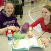 St Rose Girl Scout Troop 51160 representatives Bridget Moore and Victoria Kirkman organized a knit-a-thon recently, which was held at the Church Hill Road church hall to begin making scarves and other items for the 2012 Newtown Fund Adopt-A-Family program. Christina DeBartolomeo, left, and Sophia Davis were among those who participated. Bridget and Victoria also solicited knitting projects from members of the community including residents at Masonicare, Nunnawauk Meadows and Maplewood at Newtown.   (Voket photo)