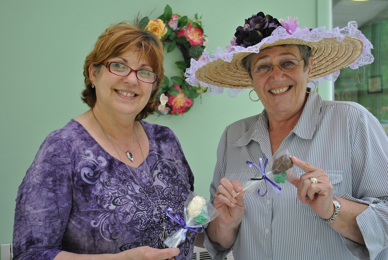 Newtown Senior Center Director Marilyn Place, left, and Commission on Aging board member Karen Aurelia show off the chocolate and white chocolate roses that they crafted, to present to each of the women attending the Annual Mother's Day Bingo and Tea.  (Crevier photo)