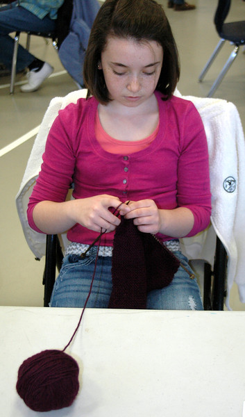 Casey Muckell was among the Girl Scouts who participated in a special knit-a-thon at St Rose Gathering Hall in early May.   (Voket photo)