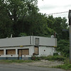 A former Shell gas station/convenience store is pictured at 67 Church Hill Road. The owner of Newtown Mobil, a gas station/convenience store that lies across the street at 64 Church Hill Road, has filed a court appeal challenging the town Zoning Board of Appeals' recent granting of setback variances for 67 Church Hill Road, where a new gas station/convenience store is proposed.  (Gorosko photo)