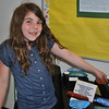 "Third grade student Charlotte Cartelli is excited to point out the Native American-inspired percussive pod she made as part of a study on design, music, and clay art.   (Crevier photo)<br /> <br /> PLEASE NOTE: The full collection of photos that made up the slideshow that accompanied this story online can be found in a separate gallery, here:<br />  <a href=""http://photos.newtownbee.com/Journalism/Special-Events/Head-OMeadow-Presents-Annual/23297110_Hrnvtc#!i=1880018531&k=F3g2Qc7"">http://photos.newtownbee.com/Journalism/Special-Events/Head-OMeadow-Presents-Annual/23297110_Hrnvtc#!i=1880018531&k=F3g2Qc7</a>"