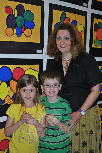 "HOM art teacher Donna Perugini and students Brian and Kristin Lageman pause in front of constructed circles made by the grade one classes, during the HOM Annual Art Show, Monday, May 21.   (Crevier photo) (Crevier photo)<br /> <br /> PLEASE NOTE: The full collection of photos that made up the slideshow that accompanied this story online can be found in a separate gallery, here:<br />  <a href=""http://photos.newtownbee.com/Journalism/Special-Events/Head-OMeadow-Presents-Annual/23297110_Hrnvtc#!i=1880018531&k=F3g2Qc7"">http://photos.newtownbee.com/Journalism/Special-Events/Head-OMeadow-Presents-Annual/23297110_Hrnvtc#!i=1880018531&k=F3g2Qc7</a>"