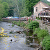 Spectators flood toward railings and overhangs to watch the nearly 4,000 numbered yellow ducks bob along on the Pootatuck River's current Saturday, May 26.   (Bobowick photo)