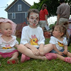 Seated in the shade wearing silk screened duck shirts, and in one case a sun bonnet, were toddlers and cousins Leah Mangino, Hope Venezia, and Morgan Capone.   (Bobowick photo)