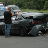 This Acura coupe received heavy damage in a rear-ender collision that occurred on South Main Street at its intersection with Ethan Allen Road about 9:04 am on May 30. Police said that motorist Joseph Rzasa, 25, of New Milford, who was driving a 1994 Acura Integra coupe southward on South Main Street, stopped and was waiting to make a left turn onto eastbound Ethan Allen Road, when the Acura was struck from behind by southbound motorist Chelsey Parks, 20, of Moultonborough, N.H., who was driving a 2008 Mazda 3 sedan. There were no injuries. Police issued Parks an infraction for failure to drive a reasonable distance apart. The accident caused travel delays in the area.  (Gorosko photo)