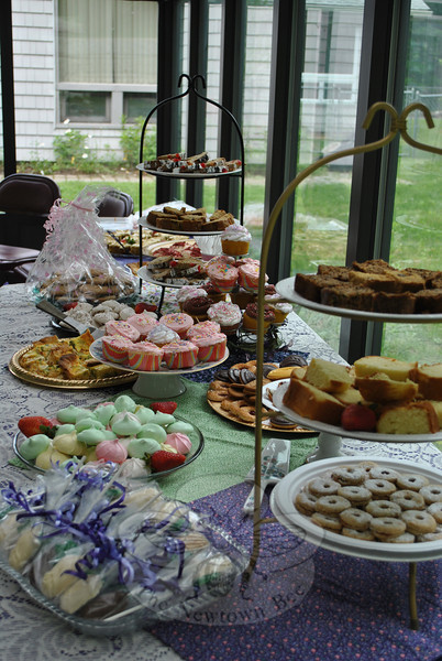 An array of homemade treats fills a table prior to the start of the tea party honoring mothers at  Newtown Senior Center May 23. Volunteers, Senior Center Director Marilyn Place, and Commission on Aging board member Karen Aurelia donated the baked goods. (Crevier photo)