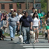 Shown are some of the hundreds of people handling their leashed dogs who attended the third annual Strutt Your Mutt fundraising event on Saturday, May 19, at the Fairfield Hills campus.   (Gorosko photo)