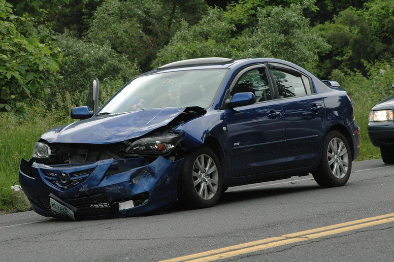 An Acura coupe received heavy damage in a rear-ender collision that occurred on South Main Street at its intersection with Ethan Allen Road about 9:04 am on May 30. Police said that motorist Joseph Rzasa, 25, of New Milford, who was driving a 1994 Acura Integra coupe southward on South Main Street, stopped and was waiting to make a left turn onto eastbound Ethan Allen Road, when the Acura was struck from behind by southbound motorist Chelsey Parks, 20, of Moultonborough, N.H., who was driving this 2008 Mazda 3 sedan. There were no injuries. Police issued Parks an infraction for failure to drive a reasonable distance apart. The accident caused travel delays in the area.  (Gorosko photo)