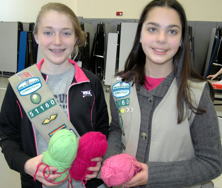 St Rose Girl Scout Troop 51160 representatives Bridget Moore and Victoria Kirkman, pictured, organized a knit-a-thon recently, which was held at the Church Hill Road church hall to begin making scarves and other items for the 2012 Newtown Fund Adopt-A-Family program. Bridget and Victoria also solicited knitting projects from members of the community including residents at Masonicare, Nunnawauk Meadows and Maplewood at Newtown.   (Voket photo)