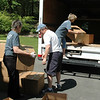 Pat McLaughlin, Maria Roy and Pam McLaughlin fill a second box truck with donations that had been collected during Mrs McLaughlin's first Soles4Souls collection in Newtown. The May 12 packing up was the culmination of six weeks of donations from fellow Newtown residents. More than 10,000 pairs of shoes were collected.  (Voket photo)