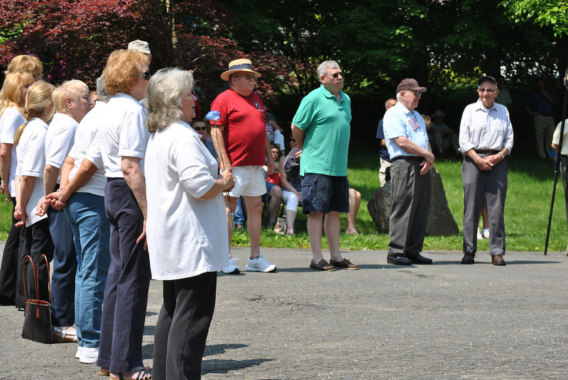 "Members of the VFW Post 308 Ladies Auxiliary stand at attention as surviving veterans of the armed forces are honored at the May 28 Memorial Day service.  (Crevier photo)<br /> <br /> PLEASE NOTE: The full collection of photos that made up the slideshow that accompanied this story online can be found in a separate gallery, here:<br />  <a href=""http://photos.newtownbee.com/Journalism/Special-Events/VFW-Memorial-Day-Service/23298481_xfkVbV#!i=1880143633&k=8MwBFsS"">http://photos.newtownbee.com/Journalism/Special-Events/VFW-Memorial-Day-Service/23298481_xfkVbV#!i=1880143633&k=8MwBFsS</a>"
