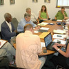 "Members of Newtown's new Charter Revision Commission, clockwise from left, James Ritchie, Dr George Coleman, John Godin, George ""Nick"" Schmidt, Michelle Embree Ku, Craig Lehecka, Anthony Filiato, Allan Song and Robert Hall chat with Legislative Council Chairman Jeff Capeci (in foreground) during the commission's first regular meeting July 16. Commission Clerk Arlene Miles is also pictured taking notes.   (Voket photo)"