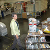 Newtown/Sandy Hook Postmaster Cathy Zieff looks over the trays of mail being prepared for carrier delivery early one morning at the Commerce Road facility. Ms Zieff was recently promoted into the position after serving in similar capacities in Kensington, Darien and North Haven.   (Voket photo)
