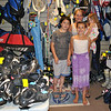 Bonnie Bianco, who owns Replay Sports and Clothing Consignment Shop on South Main Street, along with husband Louis, stands amid a collection of gently used sports equipment, along with children, Carl, 11, Grace, 10, and Reinna, 3. As parents of active children, the Biancos realize they are not the only family with rapidly outgrown, but still usable, sports equipment and clothing. Replay provides a means for families to recycle sports items and name brand children's clothing.     (Crevier photo)