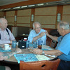 Former congressman and US Senate candidate Chris Shays was stumping for votes and chatting with constituents in Newtown on July 10. While at the Blue Colony Diner, Mr Shays took a moment to sit for grace over breakfast with, from left, Pastor Ron Nugent, Bill Pasons of the Full Gospel Businessman's Fellowship, and Paul Daria.   (Voket photo)