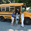 Nunnawauk Meadows resident Regina Raslavsky is assisted off of the bus by former owner-operator LeReine Frampton, left, as Golden Opportunities President Knettie Archard points the way to the Holy Cow Ice Cream Shop. Golden Opportunities, a compassionate elder outreach organization, treated Nunnawauk Meadows residents to free ice cream at the Church Hill Road Holy Cow Ice Cream Shop, Wednesday, July 11. Ms Frampton donated her time and MTM Transportation donated the use of the bus to transport residents.     (Crevier photo)