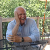Chris Shays, who is running to fill the seat of retiring Senator Joe Lieberman, shared a light moment with reporters during an interview on the patio of Stone River Grille on July 10. During his stop in Sandy Hook, Mr Shays heard about the challenges facing small businesses like the local Sandy Hook restaurant from owner Gary Seri.      (Voket photo)