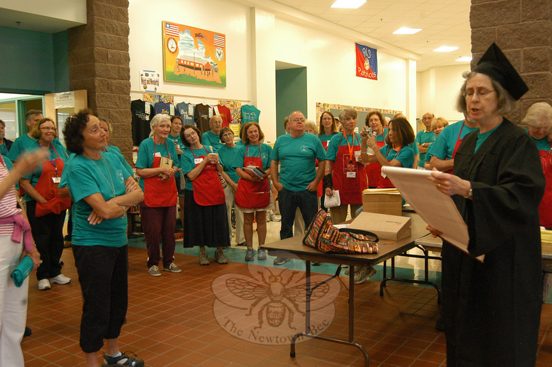 Friends of the C.H. Booth Library's Denise Kaiser, right, spoke to assembled book sale volunteers before doors opened for this year's Annual Friends of Booth Library Book Sale.  (Hallabeck photo)