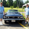 Newtown Lions Club members Kevin Corey, left, and Alan Jacobs stand with this year's Ford Mustang up for raffle through an annual fundraising effort by the club, outside the Annual Friends of Booth Library Book Sale on Monday, July 16. The car was on display each day of the annual sale and $10 tickets were available for purchase. Tickets can also be purchased merchants in town.  (Hallabeck photo)