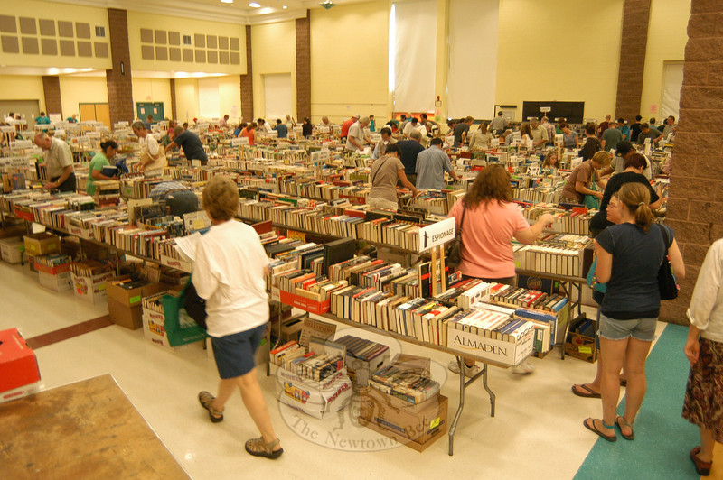 Within minutes of the doors to this year's Annual Friends of Booth Library Book Sale opening on Saturday, July 14, one of the rooms of the sale was filled with people perusing through the collection of books.    (Hallabeck photo)