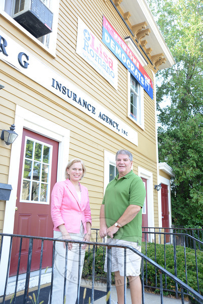 Democratic 106th District candidate Lisa Romano stands with local Democratic Town Committee Chairman Jim Juliano in front of the Democratic Headquarters on Main Street. State Attorney General George Jepson was among the dignitaries present when the party officially opened the headquarters before the commencement of the Labor Day Parade September 3.    (Bobowick photo)