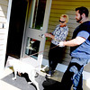 Holding the door for the new animal control facilities first canine guest on September 12 was First Selectman Pat Llodra. Assistant Animal Control Officer Matt Schaub walked the dog, Sunny, through the door on her leash.   (Bobowick photo)