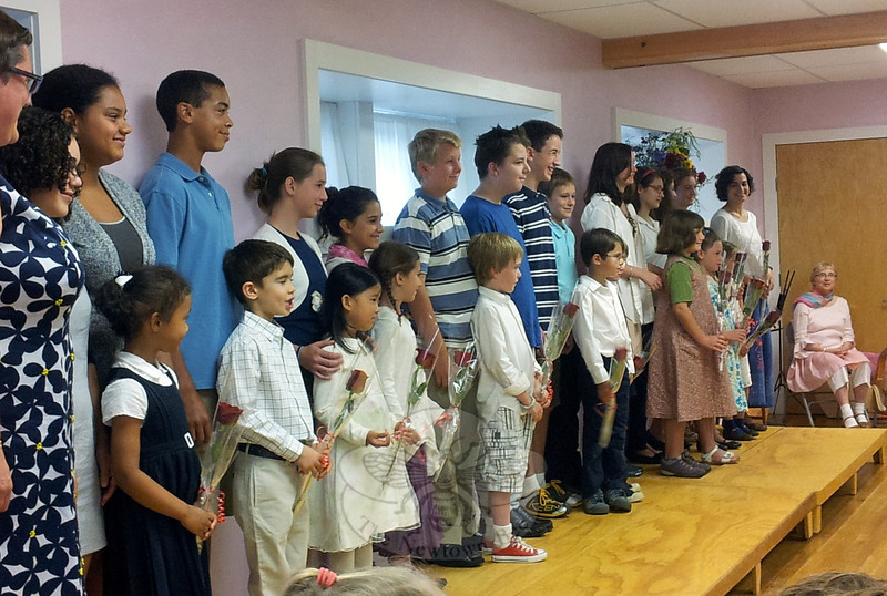 The Housatonic Valley Waldorf School held its annual Rose Ceremony on Wednesday, September 5. A roomful of students, teachers, parents, and other guests looked on as each first grade student at the school was introduced with an eighth grade student. The rose ceremony is a traditional Waldorf welcome during which each first grader receives a rose from a member of the next graduating, or lead, class. The transition from kindergarten to first grade is an important milestone at the school, marking the beginning of formal education. When the lead class graduates in June, the first graders will be there to hand them a rose in return.    (Hallabeck photo)