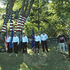 The honor guard of American Legion Post #100 of Bethel stands near the 9/11 US flag mural at the Lasher property on Dodgingtown Road in Dodgingtown Center on Tuesday morning, as Monsignor Robert E. Weiss, the pastor of St Rose of Lima Church, gives a benediction at the podium. Howard Lasher looks on during the ceremonies that were held to honor those who died in the terrorist attacks of September 11, 2001.   (Gorosko photo)