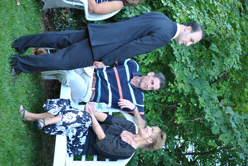 Dr Z. Michael Taweh, standing, discusses the successful afternoon with Mozart, Merlot and Mums event sponsors Phil and Debbie Clark of Claris Construction. Supporting sponsors were Newtown Savings Bank, Super Jewelers of Brookfield, and Union Savings Bank.    (Crevier photo)