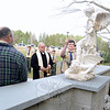 Under the guidance of Monsignor Robert Weiss, Matthew Rahtelli blesses a statue of St Mi-chael, patron saint of the military, part of a memorial he created at St Rose Cemetery for his Eagle Scout project. The memorial, which includes a sitting area, brick wall and landscaping, took 13 months and more than 400 manhours to complete.   (Bobowick photo)