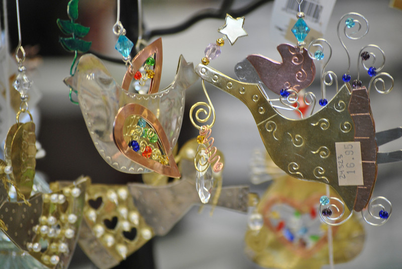 Shopping locally allows people to find out of the ordinary gifts, like these metal and crystal ornaments, says Down on Main Street owner Larry Schneider. The Shop Small concept was helpful in bringing shoppers in to his Queen Street store this past weekend.  (Crevier photo)