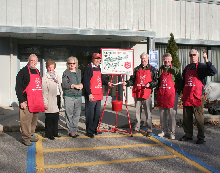 Newtown Lions Club made its annual donation to the Newtown Unit of The Salvation Army on November 26. Members of the club have also donated their time as bell ringers for the annual holiday fund drive for many years. From left are Lions Club member Fred Stakel, who coordinates the Lions Club bell ringers; Marie Sturdevant, former co-chair of Newtown's Salvation Army Committee and a current co-coordinator of bell ringers; Social Services Director Ann Piccini; Dick Sturdevant, chair of the Newtown Salvation Army unit, receiving the Lions Club donation from current club president Ray Keegan; and Lions Club members Gordon Williams and Steve Bennett. Mr Bennett is also a co-coordinator of bell ringers.   (Hicks photo)