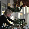 Tracey McManus decorates a table for the upcoming Holiday House Tour. Homeowners in this year's House Tour have had a hand in decorating for the 25th annual event, and Paul and Tracey MacManus and Doug and Kristen McDonald, who live in the two family house at 7 Main Street, assisted by Heidi Brisson of In The Details, have been busy preparing for Sunday's tour.  (Crevier photo)