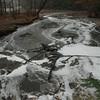 A mass of foam floats on a tributary stream moving toward the state's Pond Brook Boat Launch at the Lake Lillinonah section of the Housatonic River, in the distance. About one-half mile away on Hanover Road, a worker had inadvertently spilled the foam chemical on a driveway, after which it entered a stormwater catch basin and then found its way into the tributary.  (Gorosko photo)