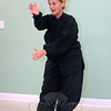 Tai chi instructor Donna Calvey put Newtown Senior Center members through their paces November 30. Ms Calvey lent her skills to a fall prevention initiative kicked off earlier this year by the regional health district using the ancient martial art to help enhance balance, increase coordination and build confidence among local seniors who are most predisposed to debilitating falls.  (Bobowick photo)