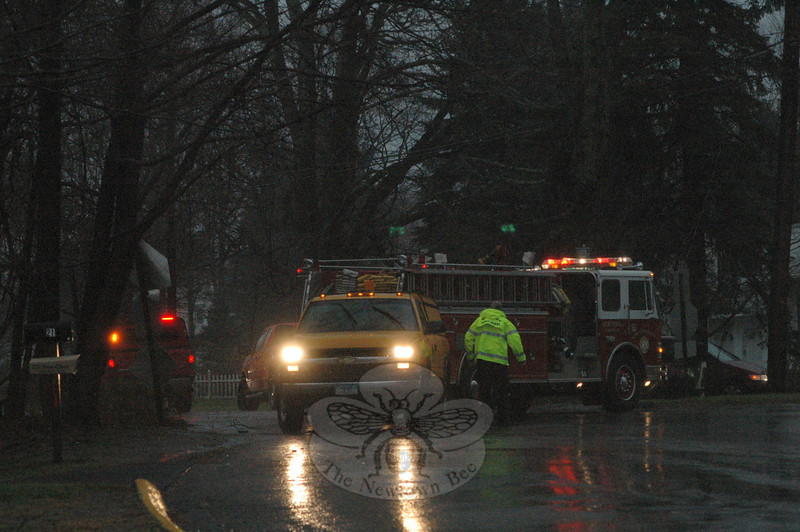A section of Queen Street, south of its intersection with Glover Avenue, was closed to traffic temporarily on Wednesday afternoon, as firefighters and public works crews were on the scene to deal with utility lines that were brought down by a fallen tree limb amid high winds and heavy rains.  (Gorosko photo)