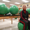 "Reed Intermediate School health and wellness teacher Michelle Failla sits in her classroom where her ""Ball Sit to Stay Fit"" program earned her a this year's intermediate/middle school level Outstanding Program Award from the Connecticut Association for Heath, Physical Education, Recreation and Dance.  (Hallabeck photo)"