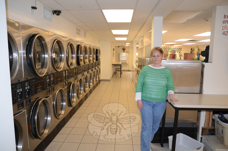 The noon-hour on a Monday at PJ's Laundromat in Sandy Hook used to be pretty busy. But since the events of 12/14, owner Sharon Doherty says business remains down, some former customers cannot bring themselves to come back, and the wait for a promised state grant to help her pay overdue bills is becoming increasingly frustrating.    (Voket photo)
