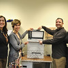 From left, Newtown Fund Vice President Anne Ragusa, Kevin's Community Center board of directors member Dr Della Schmid, Newtown Fund board member Reverend Jim Solomon, and Kevin's Community Center Clinic Director Linda Pinckney show off the Lexmark copier/printer/fax, one of two new printers Kevin's Community Center was able to purchase, thanks to a donation by The Newtown Fund.     (Crevier photo)