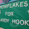 Snowflakes and banners created in response to 12/14 for a PTA drive to decorate Chalk Hill School in Monroe for Sandy Hook School arrived at the school on Thursday, February 28.    (Hallabeck photo)