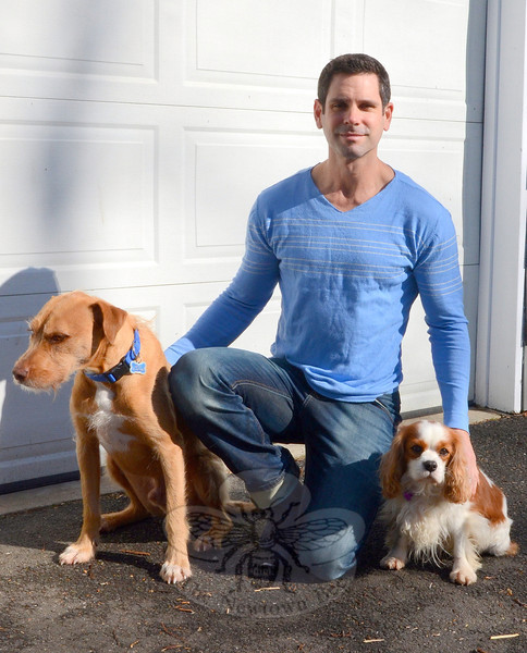 "Jeff Morgan relaxes with his two dogs outside his new home in Newtown. The renowned Israeli dog trainer, author, and kennel keeper recently relocated back to the states, and is lecturing as well as taking on local clients who are eager to train the most ""untrainable"" pooches.    (Voket photo)"