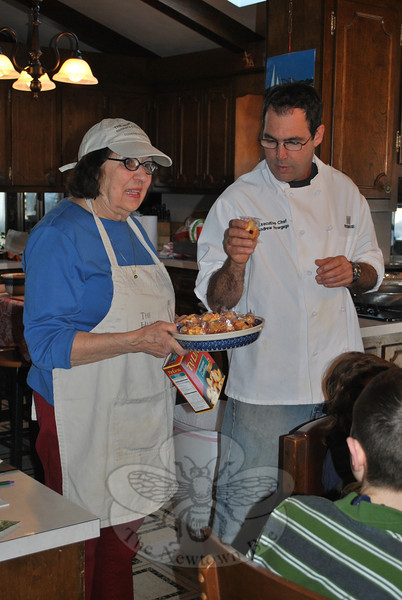 Chef Howgego, standing with Lorraine Hurley, was at The Hurley Kitchen on South Main Street for a special Chinese cooking demonstration, February 21.	(Crevier photo)