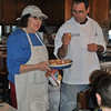 Chef Howgego, standing with Lorraine Hurley, was at The Hurley Kitchen on South Main Street for a special Chinese cooking demonstration, February 21.(Crevier photo)