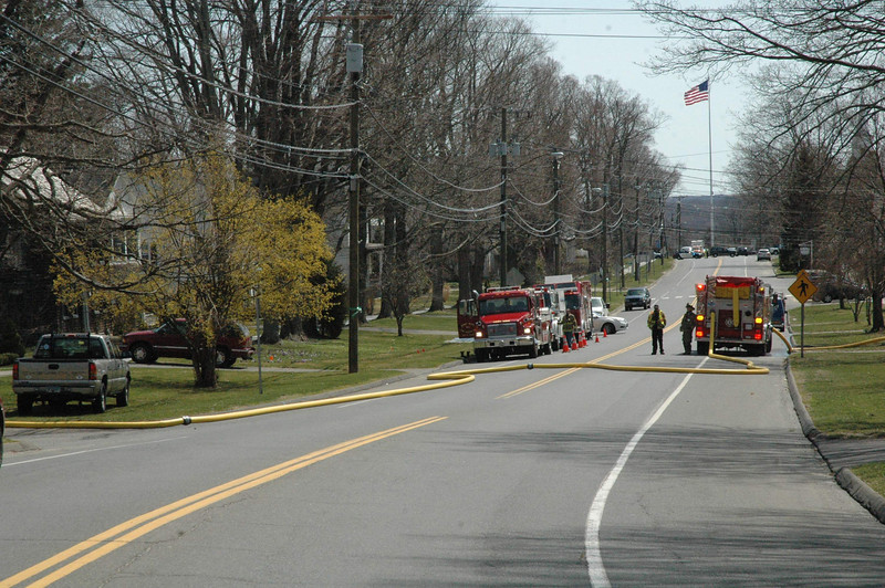 Traffic had to be diverted off Main Street due to hose lines and apparatus in the roadway while firefighters fought a barn fire on April 9.   (Gorosko photo)