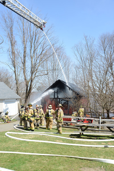Volunteer firefighters from all five local fire companies responded to a barn fire midday on Tuesday, April 9, at 64 Main Street. The blaze destroyed the barn and most of its contents. There were no injuries. (Bobowick photo)