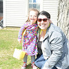 Emma Melton hugs Michelle Weinstein during the Easter egg hunt at Nunnawauk Meadows.    (Bobowick photo)
